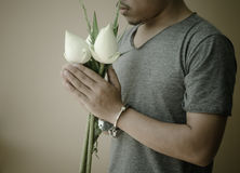 Young man in handcuffs and lotus in hand Royalty Free Stock Photos