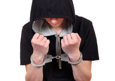 Young Man in Handcuffs Stock Images