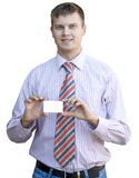 Young man handing a blank business card Royalty Free Stock Photos