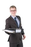 Young man is handing over a file Stock Photo