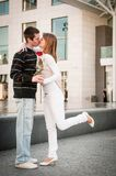 Young man handing over a flower to woman Royalty Free Stock Photos