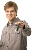 Young man handing over ignition keys Royalty Free Stock Image