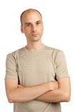 Young man with hands crossed. Handsome young man with hands crossed Royalty Free Stock Image