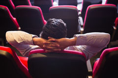 Young man with hands head watching a film Stock Images