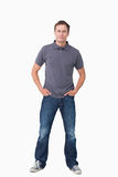 Young man with hands in his pockets. Against a white background Royalty Free Stock Photography