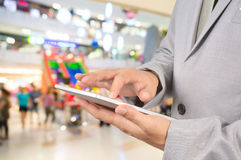 Young Man Hands holding Tablet in Shopping Mall or Department St Stock Image
