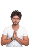 Young man with hands in prayer Royalty Free Stock Images