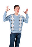 Young man hands up confused Stock Photography