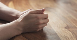 Young man hands waiting nervous at the table. Wide photo Royalty Free Stock Photography