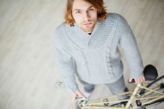 Young man. Handsome bicyclist looking at camera Royalty Free Stock Images