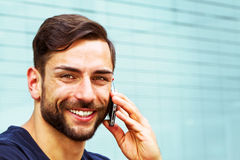 Young man on handy. Young, modern man with smart phone Stock Image