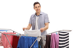 Young man hanging clothes Stock Photo