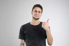 Young man happy in black shirt isolated studio stock images