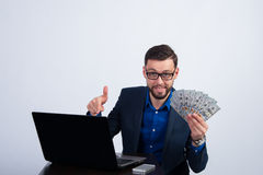 Young man happy with earnings in the Internet Royalty Free Stock Photography
