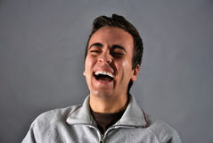 Young man with happy expression Stock Images