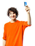 Young man happy holding credit card portrait Stock Photography