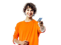 Young man happy holding credit card portrait Royalty Free Stock Image