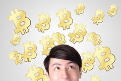 Young man happy looking bitcoin Stock Image
