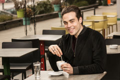 Young man happy smiling, looking at camera, coffee cup Stock Photos