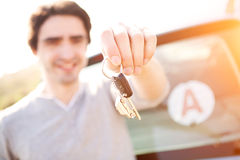 Young man happy to get his driving license Stock Photos