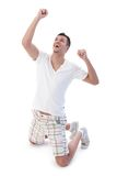 Young man happy for victory Stock Photography