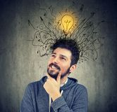 Young man has a bright idea. Young happy man has a bright idea and many thoughts Stock Photos