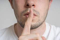 Free Young Man Has Finger On Lips And Showing Be Quiet Gesture Stock Images - 97634634