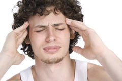 Young man has a headache Royalty Free Stock Image