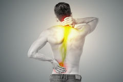 Young man has pain in his back. Man is touching his back and neck out of pain stock illustration