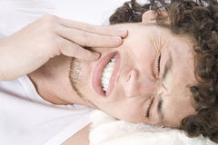Young man has a toothache Stock Images