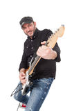 Young man with hat and beard play on electric guitar with enthusiasm. Isolated on white Stock Image