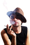 Young man in  hat with cigarette Stock Photo