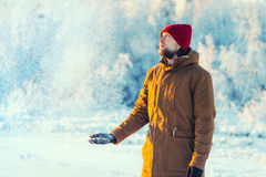 Young Man in hat playing with snow Outdoor Winter Stock Photos