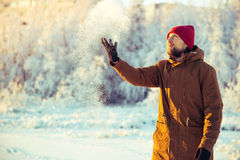 Young Man in hat playing with snow Outdoor Winter Royalty Free Stock Photo