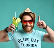 Young man in hat and red sunglasses hold cocktail drink juice happy screaming Royalty Free Stock Photography
