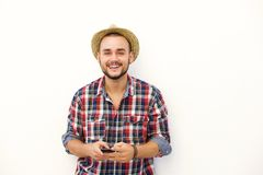 Young man with hat smiling with cell phone Stock Photos