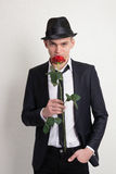 A young man in a hat and a tie with a rose. Royalty Free Stock Photo