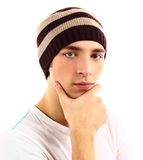 Young man in a hat is touching his face Royalty Free Stock Image