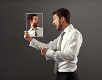 Man have a conflict with himself Stock Photo