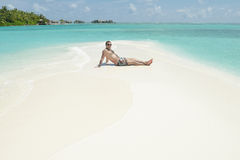 Young man have fun and relax on beach Royalty Free Stock Photos