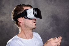 Man have fun with virtual reality glasses. Young man have fun with virtual reality glasses royalty free stock photo