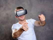 Man have fun with virtual reality glasses. Young man have fun with virtual reality glasses stock photography
