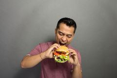 Young Man have a great desire to eat a burger Stock Image