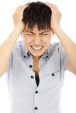 Young man have a headache and feel very painful. Over white Royalty Free Stock Photo