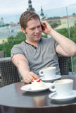 Young man have a rest with cup of coffee Stock Images