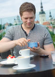 Young man have a rest with cup of coffee Royalty Free Stock Photo
