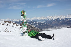 Young man have a rest on the ski slope. Stock Images