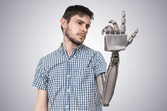Young man have robotic hand as a replacement for his hand. 3D rendered illustration of hand Stock Photo