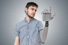 Young man have robotic hand as a replacement for his hand. 3D rendered illustration of hand Stock Images