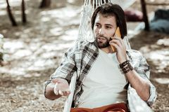 Free Young Man Having An Important Phone Call Stock Photography - 127818532